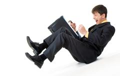metaphorical image of screaming businessman sliding down gradually - stock photo
