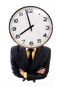 fish-eye of businessman standing with crossed arms and clock instead his head - stock photo