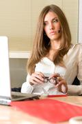Modern businesswoman sitting before laptop and looking at its monitor Stock Photos
