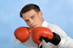 Image of handsome man defending himself by gloved punches gloved Stock Photos