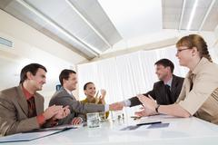 image of happy business leaders handshaking at meeting - stock photo