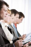 profiles of business people with their leader in front - stock photo