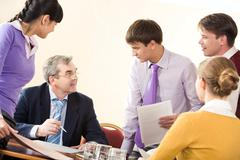 image of business partners communicating at corporate meeting in office - stock photo
