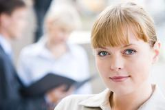 close-up of charming lady in working environment - stock photo