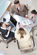 Above view of executive people communicating during meeting Stock Photos
