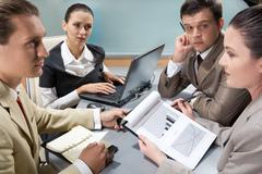 image of confident colleagues interacting during appointment - stock photo