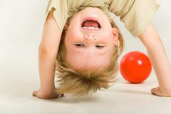 view of boy's head over heels on a white background - stock photo