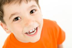 Portrait of happy boy laughing on a white background Stock Photos
