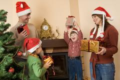 portrait of happy family celebrating cristmas at home - stock photo