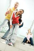 image of cheerful guy and girl standing on stairs on background of their sitting - stock photo