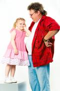 image of pretty girl leaning elbow on her daddy - stock photo