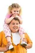 image of girl sitting on the daddy's neck and father holding her legs - stock photo