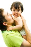 Image of father keeping his adorable little daughter Stock Photos