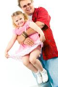 portrait of man keeping his daughter in embraces - stock photo