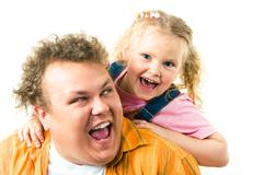 photo of happy father and daughter screaming while playing with each other - stock photo
