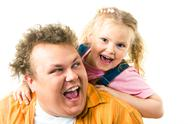 Stock Photo of photo of happy father and daughter screaming while playing with each other
