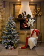 Image of nice comfortable room decorated for christmas with fir tree, toys and d Stock Photos