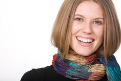 Portrait of attractive woman with scarf isolated on a white background Stock Photos