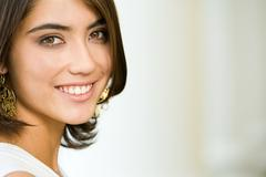 Photo of attractive lady with charming smile looking at camera Stock Photos