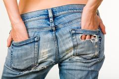 Image of female hands touching beautiful buttocks in jeans Stock Photos