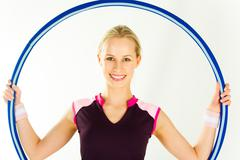 portrait of girl holding the hoop on a white background - stock photo