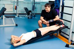image of young woman ready for exercising with her personal trainer near by - stock photo