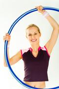 image of happy woman with half hoop on a white background - stock photo
