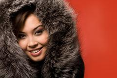 Face of beautiful girl in fur-cap looking at camera with smile Stock Photos