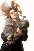 Portrait of very beautiful woman wearing fashionable winter overcoat posing befo Stock Photos