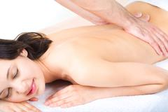 Portrait of smiling woman taking enjoyment from massage Stock Photos