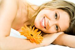 photo of young pretty woman lying in the spa salon and enjoying aromatherapy wit - stock photo