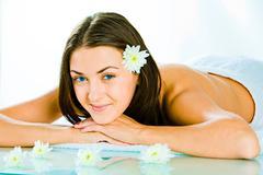 portrait of happy attractive woman resting in the salon - stock photo