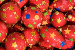 close-up of christmas balls of red color decorated with stars - stock photo