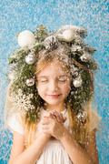 portrait of happy girl standing under christmas snowfall and enjoying it - stock photo
