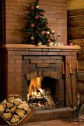 Stock Photo of image of chimney with fire inside and decorated tree on its top