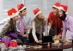 Photo of laughing co-workers interacting during corporate party in office Stock Photos