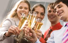 Photo of businesspeople cheering up their flutes filled with sparkling champagne Stock Photos