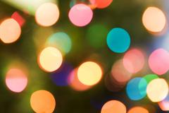colorful christmas background with glittering lights - stock photo