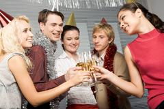 happy people toasting with glasses of champagne in hands while looking at each o - stock photo