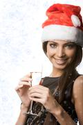Photo of cheerful woman with flute of champagne wishing you merry christmas Stock Photos