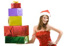 Portrait of pretty girl with christmas presents on a white background Stock Photos
