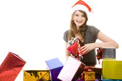 Stock Photo of portrait of young woman with different color boxes near by