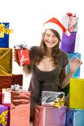 portrait of happy woman screwing up her eyes with boxes near by - stock photo