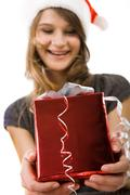portrait of smiling woman giving a present - stock photo