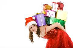Photo of tired woman holding heap of gifts on eve of new year Stock Photos