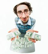 image of satisfied male holding cash on his palms and smiling - stock photo