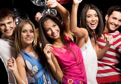 portrait of glad teens looking at camera with smiles during party - stock photo