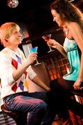 Portrait of attractive couple chatting at meeting in the bar Stock Photos