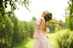 Photo of girl standing with her arms outstretched while taking pleasure in walk Stock Photos