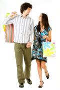 image of couple holding the bags and hands together walking - stock photo